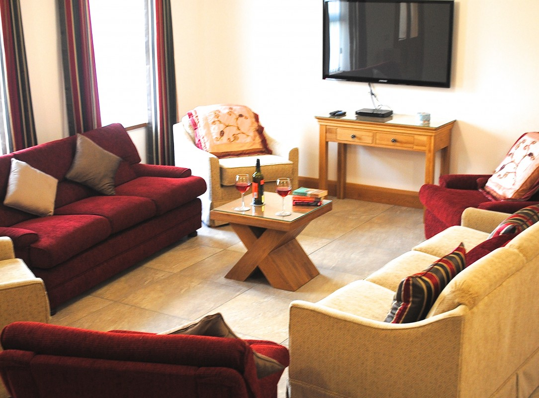 Wheelchair accessible cottages uk cottages for disabled people in the newton lodge for Living room furniture northern ireland